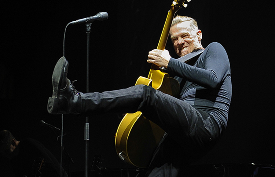 Vancouver   B.C.   January 14, 2015  Thrilling  his hometown fans-- Bryan Adams plays his legendary rock on stage in Rogers arena in Vancouver  January 14, 2015.  Adams is touring to celebrate the 30th anniversary re-release of his classic album Reckless, which contains some of his biggest hits    Mark van Manen/PNG Staff  Photographer   see  FranÁois MarchandVancouver Sun Province Entertainment review  Features   stories /WEB  00034075A [PNG Merlin Archive]
