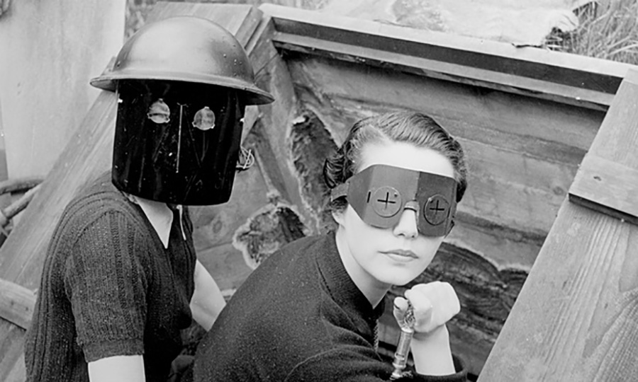 Fire masks, Hampstead, London, 1941. One of Miller's most famous war shots, this was part of a Vogue feature to show how British women were coping with the war. Photograph The Lee Miller Archives